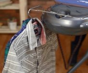 Practical system to hook the coat hangers while ironing